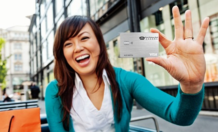 Woman Holding Royal Business Bank Visa Credit Card